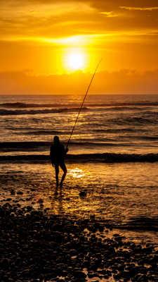 Le coucher de soleil du pêcheur
