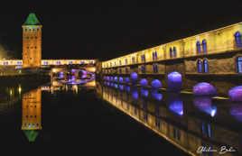 Les ponts couverts et sa tour en reflet