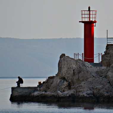 Le pêcheur et son phare par mamichat